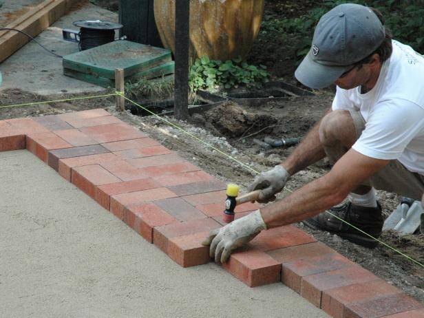 How to Lay Your Own Brick Patio Just Right - KnockOffDecor.com on Backyard Brick Pavers id=90647