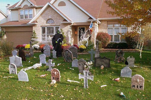 Foam and wooden tombstones in a front yard.