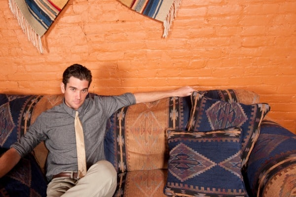 man on sofa with southwestern united states