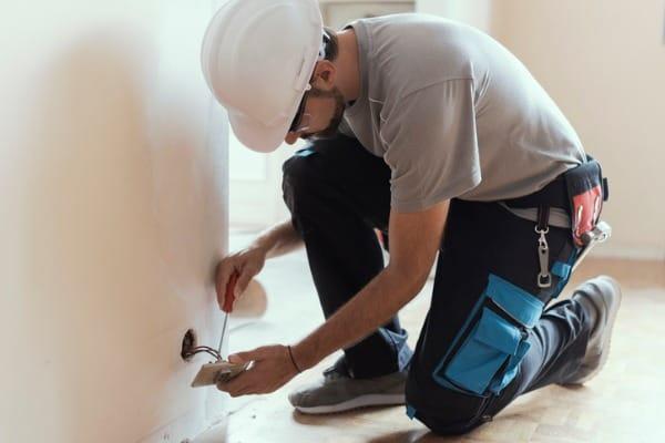 professional electrician installing socket