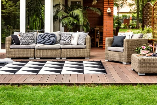 add a large outdoor rug