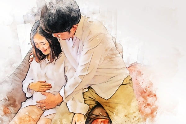 pregnant woman with husband painting