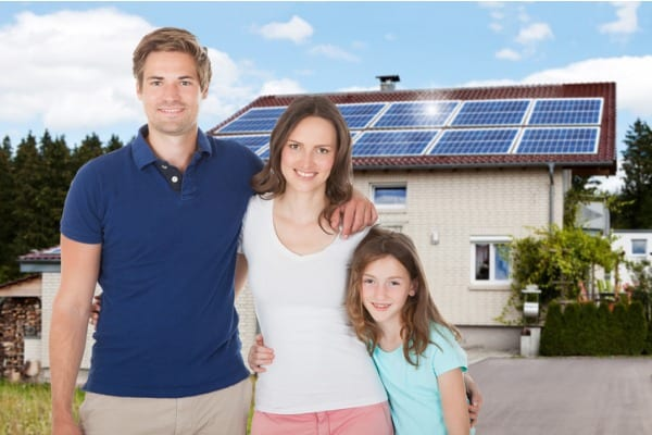 solar panels and a family
