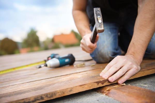 man installing wooden floor