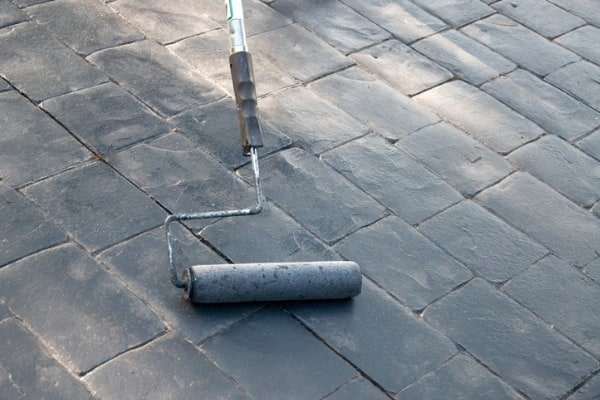 sealing driveway with roller
