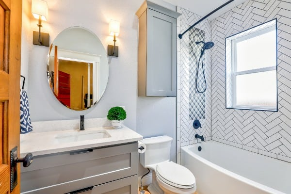 bathroom with white toilet and mirror