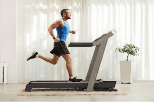 man runs on treadmill