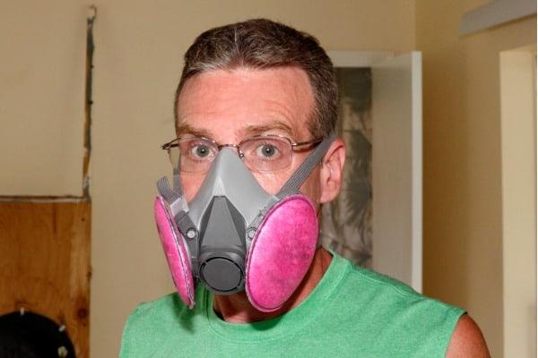 man wearing a mold mask