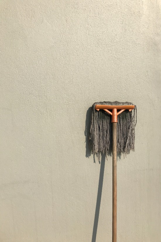 mop leans on wall
