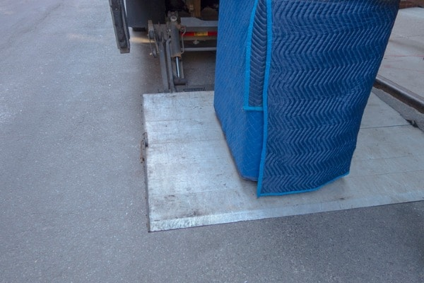 moving truck with object coated in moving blanket