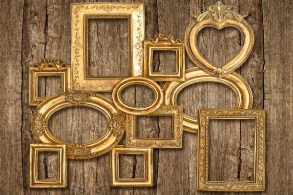 old golden frame wooden wall