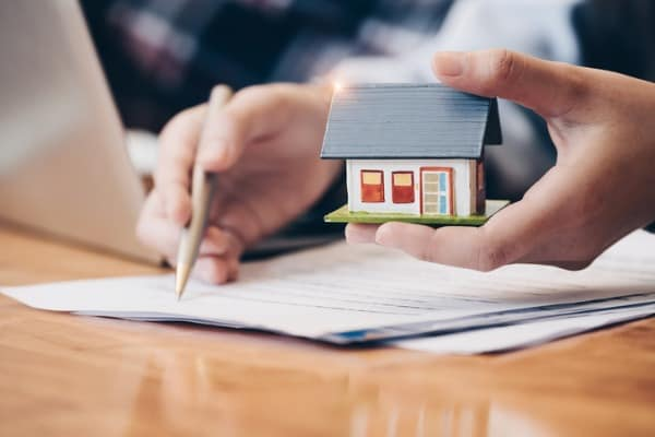 paperwork-with-small-house-at-hand