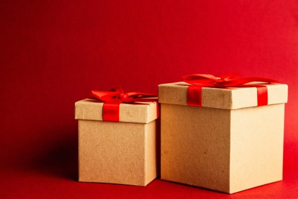 two gift boxes on red background