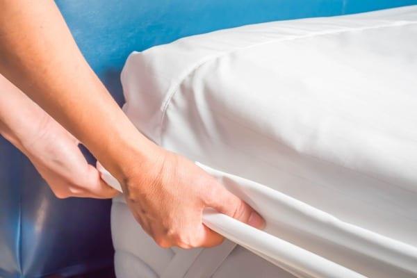 woman adding bed pad