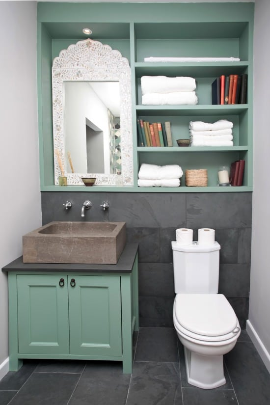 bathroom interior with shelve on wall