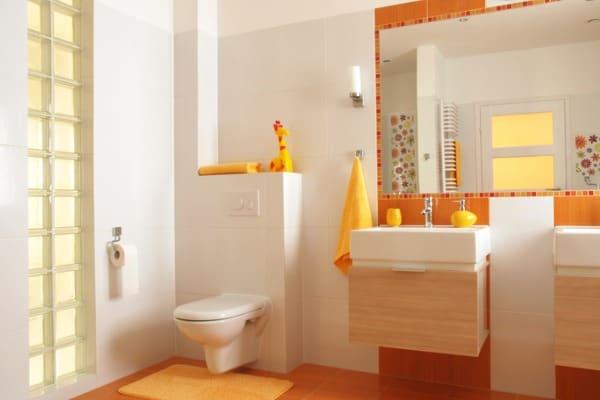 bathroom with big wall mirror