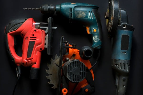 hand power tools on a black background