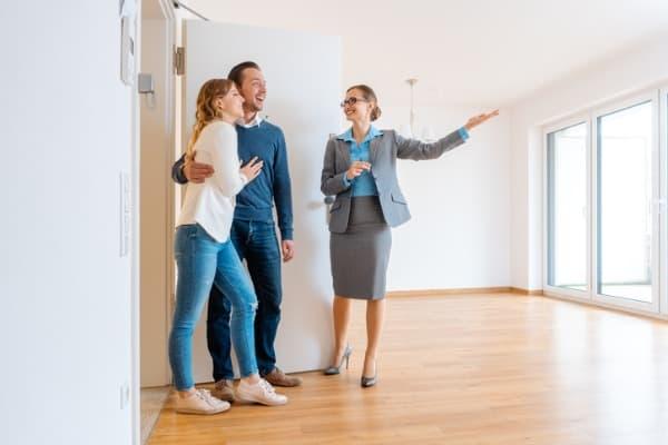 landlady showing couple the apartment