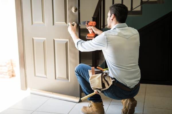 man working on a door