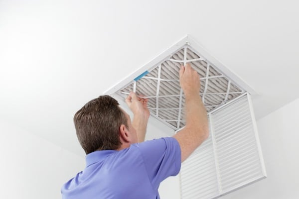 person working on air filter