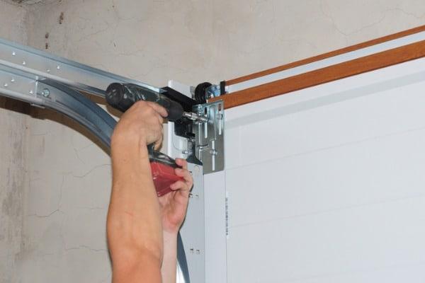 person working on garage door opener