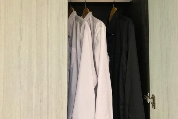 shirt hanging on closet