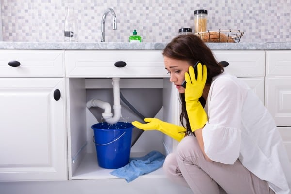 woman with plumbing problem