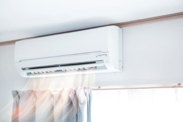 air conditioner blowing warm