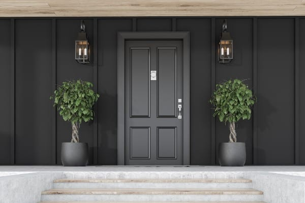 luxurious entrance door with plants on side