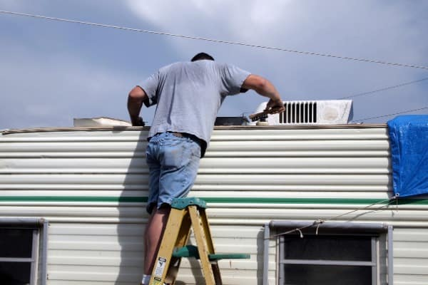 person working on making mobile home