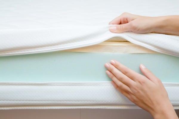 woman touching foam mattress