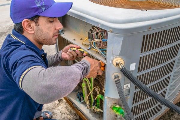 hvac pro working on air conditioner