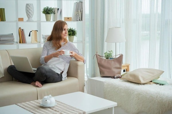woman on couch with coffe