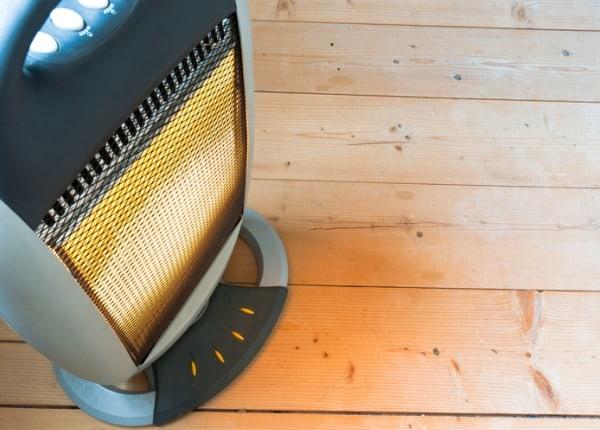 halogen-or-electric-heater-on-wooden-floor