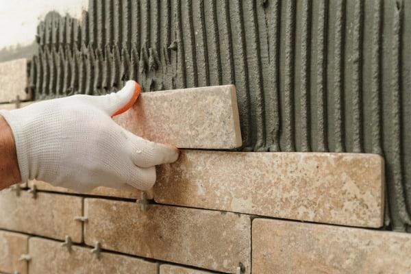 installing-backsplash-tiles-kitchen-wall