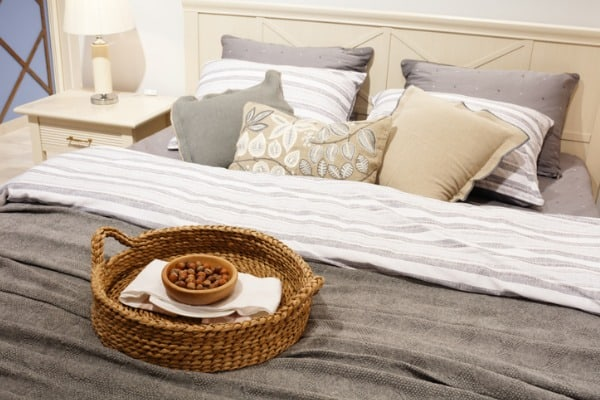 nuts-in-a-wicker-basket-on-the-bed