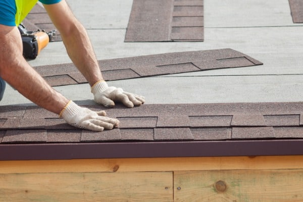 roofing-worker-installing-new-shingles