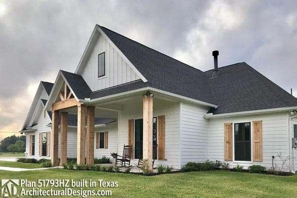 Staged in Texas, this Southern French Country house balances with the architectural style of Texas, including the wooden column and the gable rooflines, creating a rustic look.