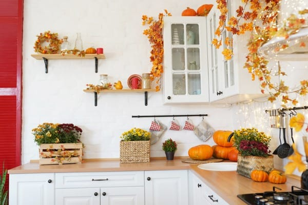autumn kitchen interior with pumpkin fallen leaves thanksgiving