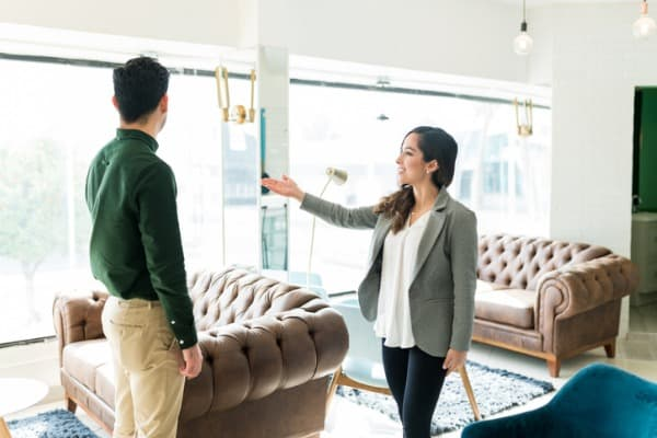 businessman exploring new office space with realtor