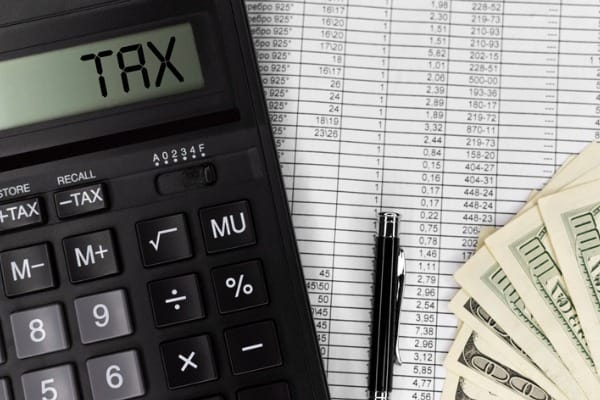 calculator with text tax calculator currency bills and pen business picture id1206036805