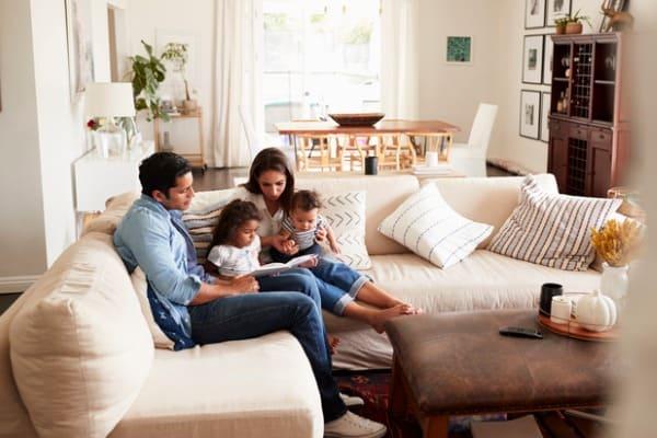 family-breathing-around-furniture
