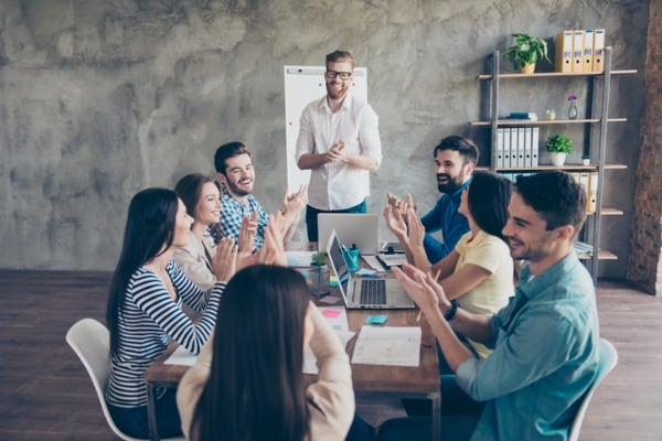 gret job successful business team is clapping their hands in modern
