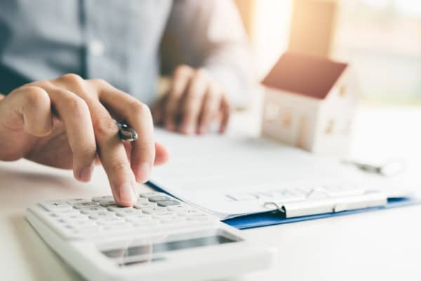 home agents are using a calculator to calculate the loan period each