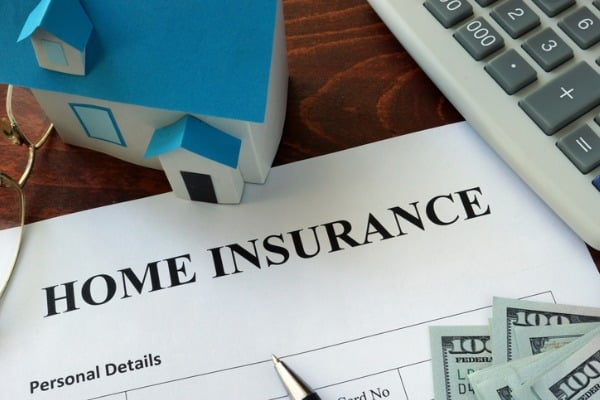 home insurance form and dollars on the table