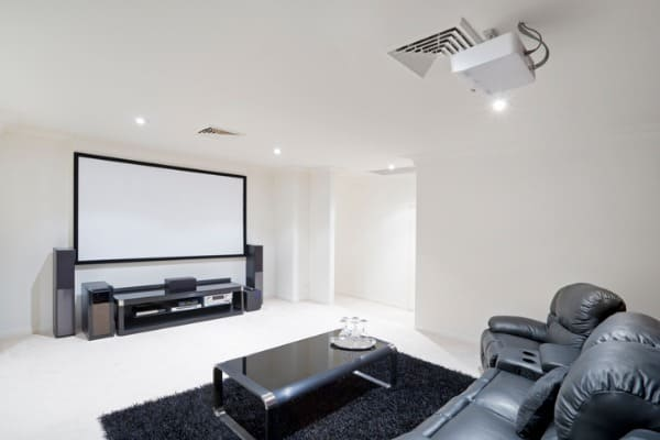 home-theater-room-with-black-leather-recliner-chairs