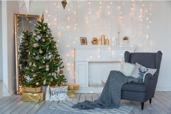 modern design room in light colors decorated with christmas tree