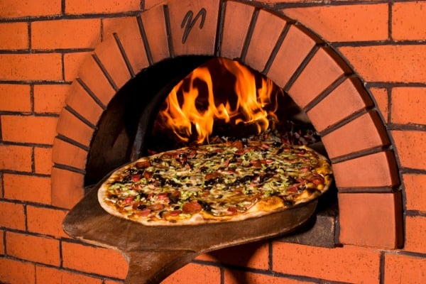 pizza-on-a-pizza-plank-and-a-light-oven