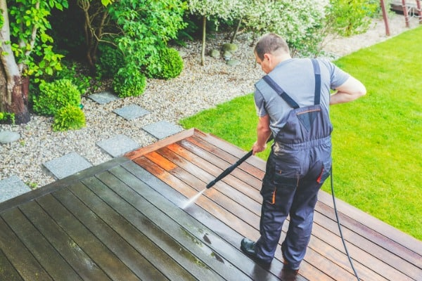 cleaning terrace with a power washer high water pressure cleaner