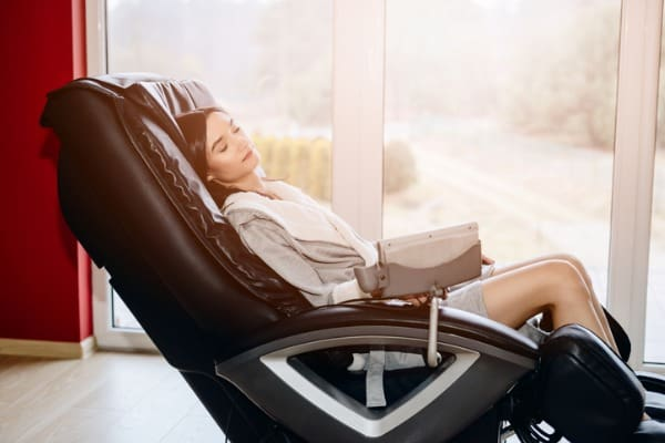 young woman relaxing on the massaging chair